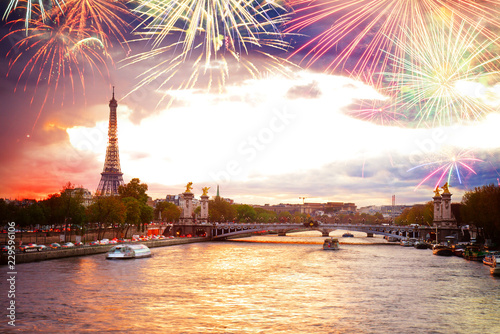 Fotografia  Alexandre III Bridge and Eiffel tower at sunset with fireworks, Paris, France