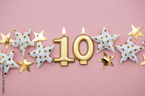 Number 10 gold candle and stars on a pastel pink background Canvas Print