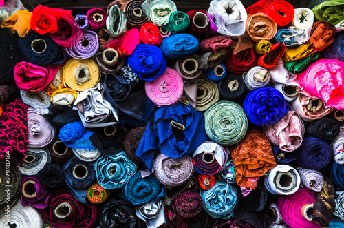 Poster Tissu Set of rolls of cloth of many colors stacked and stored