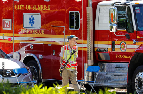 A paramedic is shown outside a building containing the