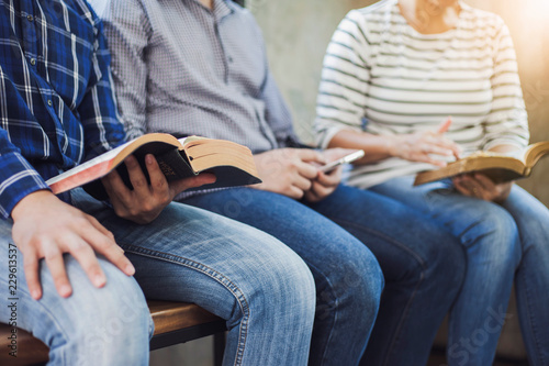 Fotografie, Tablou  Christian friends group reading and study bible together in home or Sunday schoo