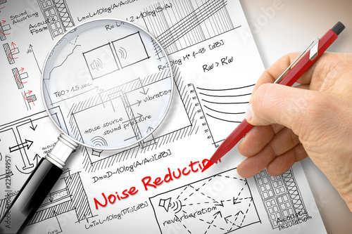 Engineer writing formulas about noise reduction in buildings - Concept image see Canvas-taulu
