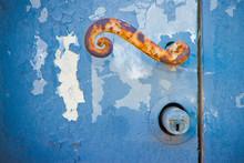 Metal Handle Detail On Wooden Door