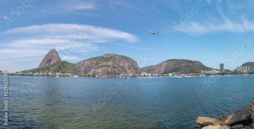 Panoramic view of plane flying over Sugar Loaf Mountain - Rio de Janeiro, Brazil