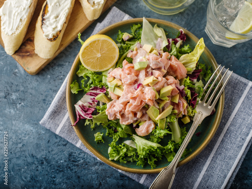Ceviche is a traditional dish from Peru. Salmon marinated in lemon with fresh lettuce, avocado and onions