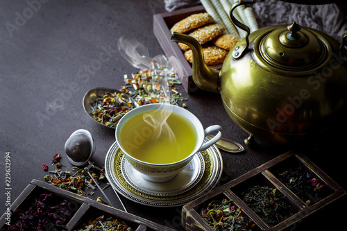 Tea in a cup on an old background Canvas Print