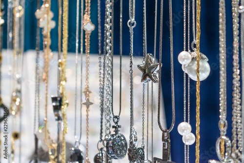 Fotografie, Obraz  Stylish beautiful bijouterie hanging on the stand in the accessories store
