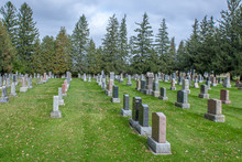 A Beautiful Graveyard Marked With Rows Of Headstones And Lined With Trees, Flowers And Walking Paths, Providing A Peaceful Setting For Visitors To Visit Departed Beloved Friends And Family Members.