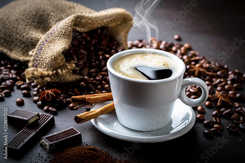 Fototapeta Black coffee in a cup on old background obraz