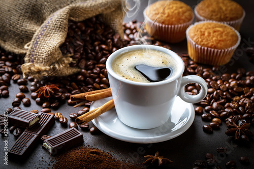 Wall Murals Cafe Black coffee in a cup on old background