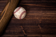 A Group Of Vintage Baseball Equipment, Bat, Baseball On Wooden Background