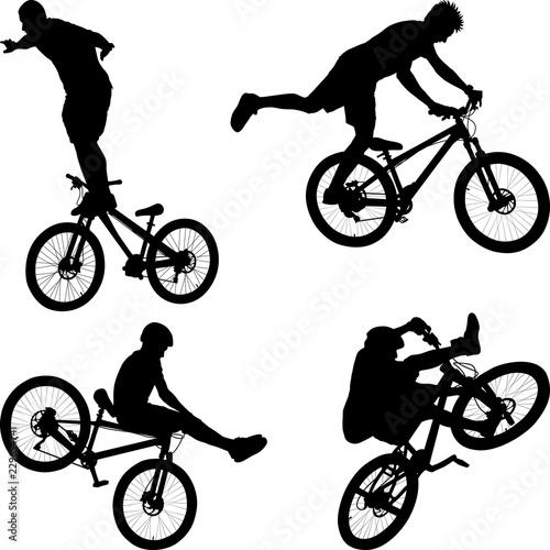 man doing bike trick Wallpaper Mural