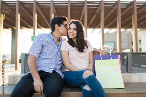 Photo  Good Looking Man Kissing Girlfriend After Shopping