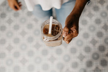 Hand Of Woman Holding Glass Of Iced Coffee I