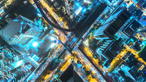 Fotografie, Obraz  Aerial view traffic road at night in downtown for transportation or traffic background