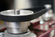 Close Up Of Pulley And Belt Drive Of Bench Drilling Machine. Copy Space. Shallow Depth Of Field.