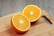 An Orange Cut Into Two Halves