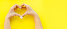 Heart From Hands On A Yellow Background