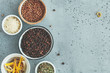 Various spice in bowls on a grey textured background. Top view, copy space.