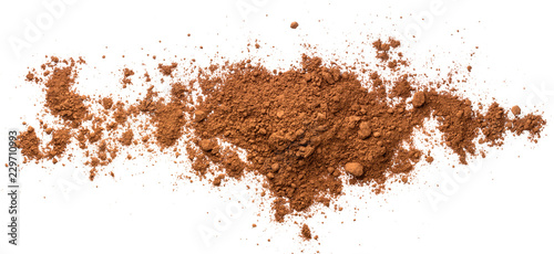Fotomural Pile cocoa powder isolated on white background. Top view