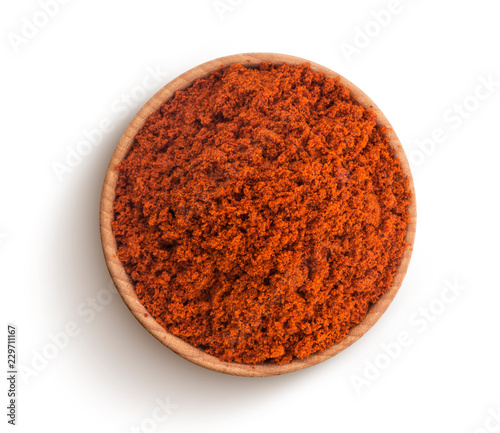 Fototapeta Red paprika powder isolated on white background. Top view obraz
