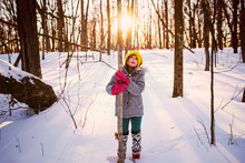 Girl Standing In The Woods Hugging A Tree, United States