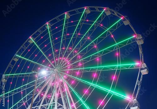 Deurstickers Antwerpen Carnival ride showing a spinning ferris wheel in action