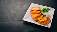Potato Cakes With Sour Cream. Potato Pancakes. Ukrainian Cuisine. On The Old Wooden Background. Free Space For Text. Top View.