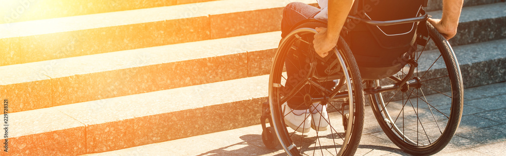 Fototapety, obrazy: cropped image of disabled man using wheelchair on street and stopping near stairs without ramp