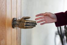 Human Hand And Door Knob Bronz...