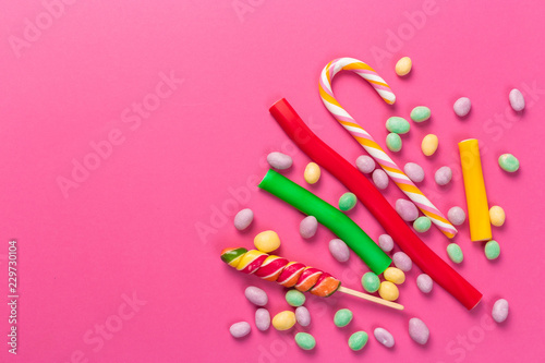 Fototapeta  Colorful lollipops on a pink background
