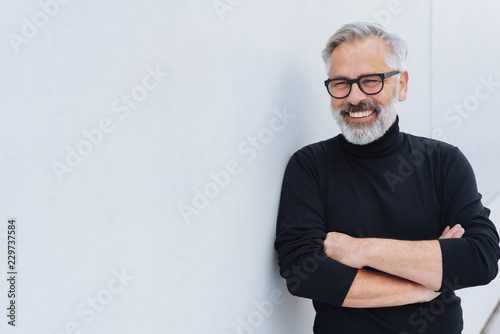 Relaxed self-assured senior man with beard
