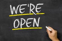 We Are Open Written On A Blackboard