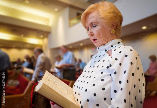 senior woman singing in church Canvas Print
