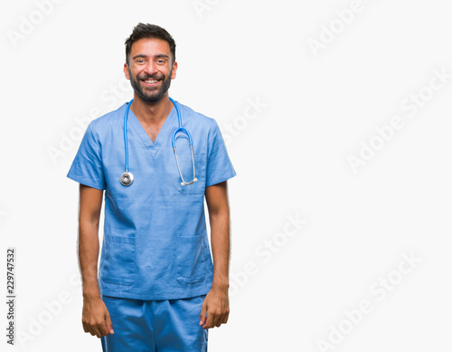 Cuadros en Lienzo  Adult hispanic doctor or surgeon man over isolated background with a happy and cool smile on face