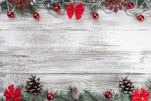 Garlands, Baubles, Snowflakes And Other Holiday Items. Fir Branches And Cones. Xmas Greeting Card. Old Wooden Christmas Background. Top View. Space For Your Text.