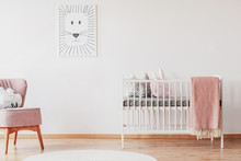 White Crib With Pillows And Pi...