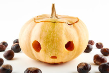 Halloween Pumpkin And Chestnuts On White Background