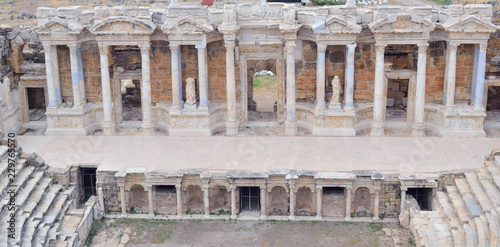 Spoed Foto op Canvas Theater Scene of ancient theater with sculptures of mythical heroes in the ancient Turkish city of Hieropolis