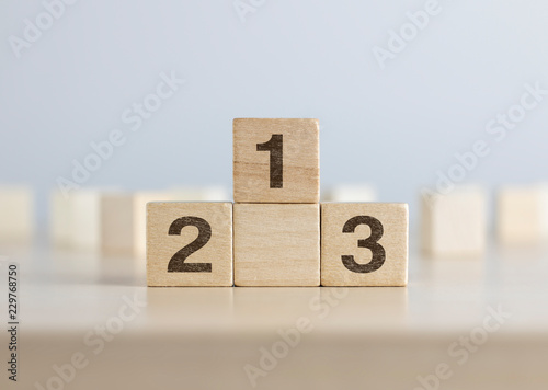 Fotografia  Wooden blocks stacking as a podium on white background