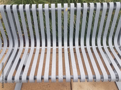 Fotografie, Obraz  wet grey metal bench or seat with water drops