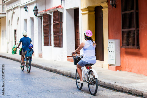 Fotobehang Zuid-Amerika land Family riding on rental bikes around the walled city in Cartagena de Indias