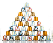 Coffee Capsules On White Backg...