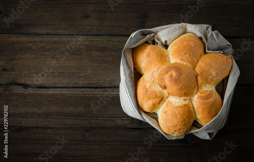 Spoed Foto op Canvas Brood white bread rolls on wooden table