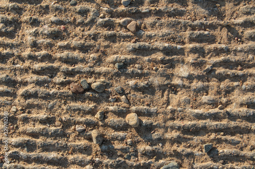 Fotografie, Obraz  Rough Grey Sunlit Concrete Background Texture With Lines and Small Stones