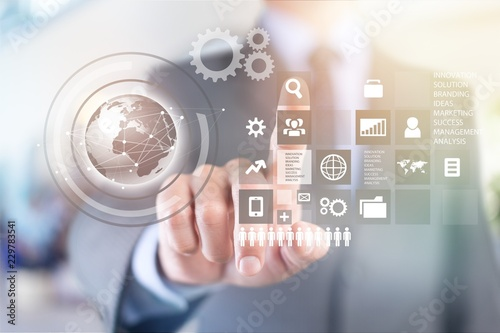 Businessman and analytics symbol on background