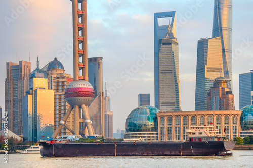 Barge by sunset Shanghai skyline