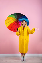 Woman With Rainbow Umbrella Ne...