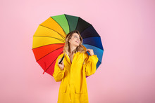 Woman With Rainbow Umbrella On Color Background