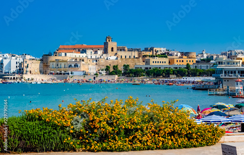 Tuinposter Poort Castle of Otranto near the beach in summer holiday, Lecce, Italy